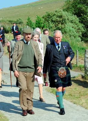 The Prince of Wales with Marc Ellington, liaison to the Cabrach Cairn Project, during a visit to Cabrach Cairn, Scotland, yesterday