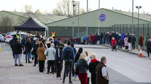 People queue at a Coronavirus testing centre in Liverpool (Peter Byrne/PA)