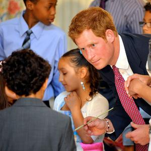 Prince Harry with children who are making presents for their mothers, during a visit to the White House