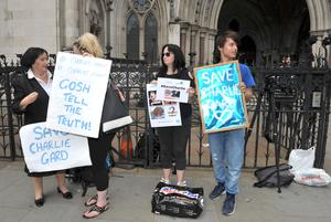 Charlie's supporters protest outside the High Court (Nick Ansell/PA)