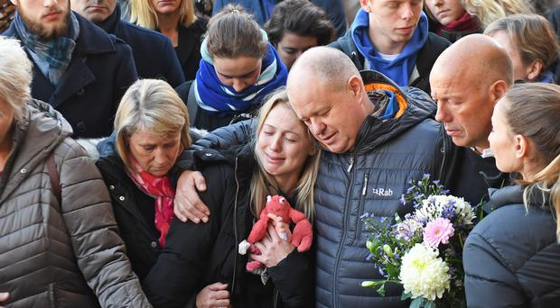 Leanne O'Brien, the girlfriend of Jack Merritt, is comforted by family members during a vigil at The Guildhall in Cambridge to honour both him and Saskia Jones after the two of them were killed in Friday's London Bridge terror attack (Joe Giddens/PA).
