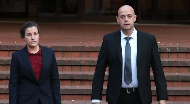 Police constables Benjamin Monk (right), who is accused of the murder of Dalian Atkinson, and Mary Ellen Bettley-Smith (left), who is accused of assaulting the footballer, leaves Birmingham Crown Court after a review hearing (Steve Parsons/PA)