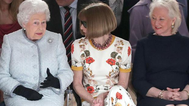 Angela Kelly, right, with the Queen and Anna Wintour at a British Fashion Council event (PA)