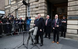 Alex Salmond speaks outside the High Court in Edinburgh after he was cleared of 13 charges last March (Andrew Milligan/PA)