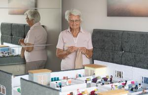 Margaret Seaman with her model of the Knittingale Hospital, which she has created to raise funds for the NHS (Joe Giddens/ PA)