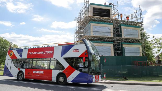 A tour bus makes its way past broadcast studios being erected on the Long Walk in Windsor (Andrew Matthews/PA)