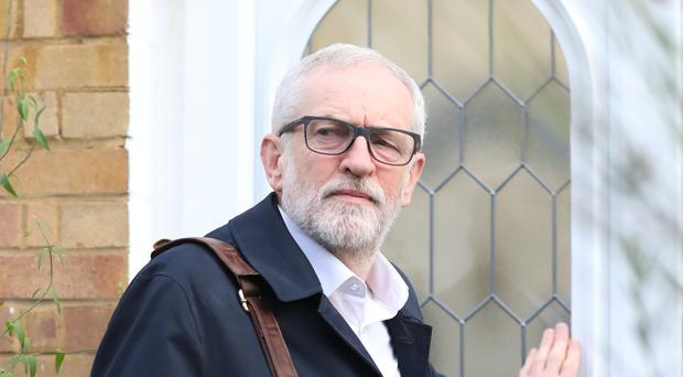 Labour Party leader Jeremy Corbyn leaves his home in Islington, north London (Isabel Infantes/PA)