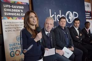 KidsOR founders Nicola Wood (left) and Garreth Wood (second left) speaking at the World Economic Forum in Davos, Switzerland (KidsOR/PA)