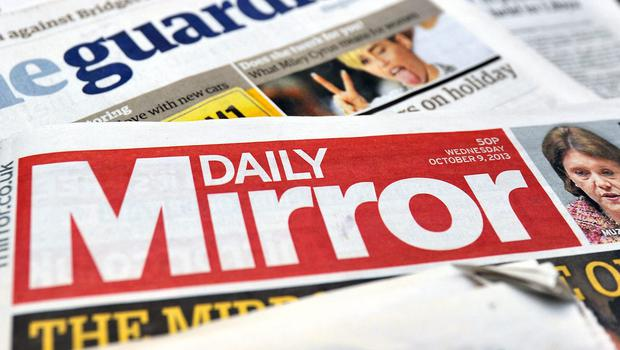 Trinity Mirror's £126.7m deal to buy titles including the Daily Express and the Daily Star has been referred to Britain's media watchdog after the Government intervened on the grounds of public interest