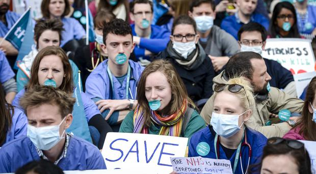 Junior doctors and supporters of the BMA strikes wear face masks and stickers over their mouths during the strikes (Ben Birchall/PA)