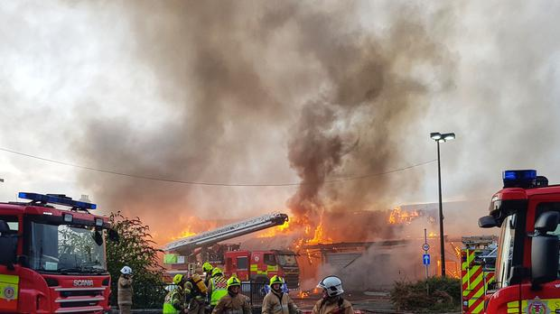 The fire started in the roof of the building before spreading (Photographer Dylan Drummond)