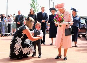 Lewis Connett has a little meltdown when presenting the Queen with flowers