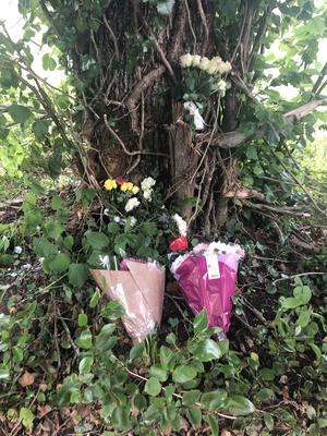 Floral tributes left at the scene of the crash (Eleanor Barlow/PA)