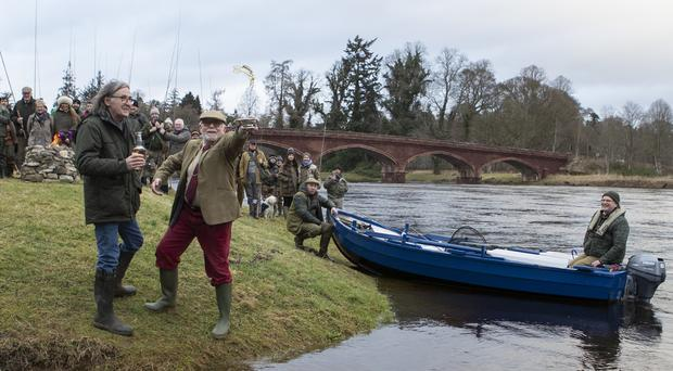 Musician Dougie MacLean and provost of Perth and Kinross Dennis Melloy carry out the traditional blessing of the River Tay (Jane Barlow/PA)