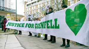 Protesters outside the Grenfell Tower public inquiry in London, where the second part of the inquiry into the Grenfell Tower fire, examining the circumstances and causes of the disaster, is due to start later (Kirsty O'Connor/PA)