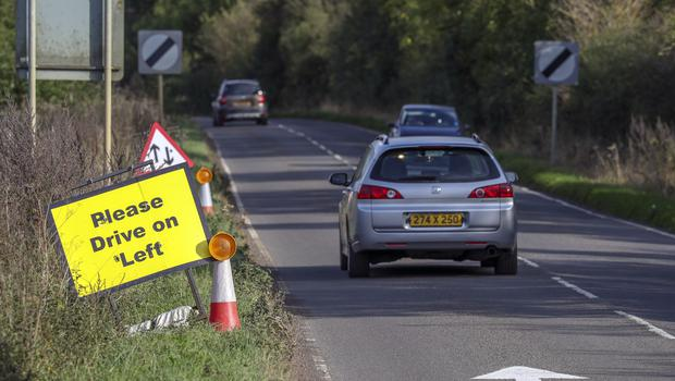 A Please Drive On Left sign near RAF Croughton (Steve Parsons/PA)