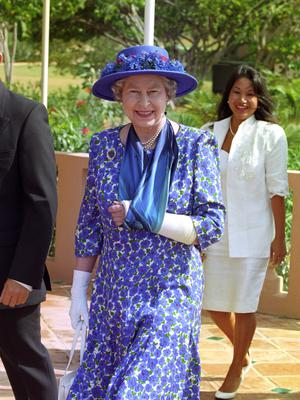 The Queen wears her plaster cast arm in a sling while visiting Anguilla (Martin Keene/PA)