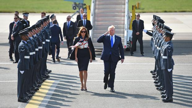 Donald Trump and his wife Melania arrive at Stansted Airport in Essex (Joe Giddens/PA)
