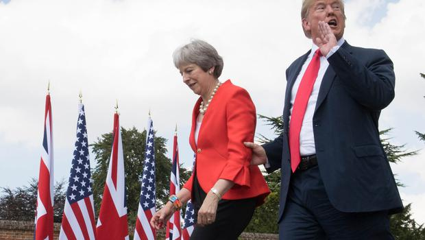 Donald Trump with Prime Minister Theresa May last year (Stefan Rousseau/PA)