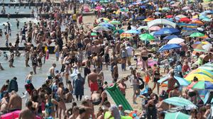 Huge numbers of people gathered on Bournemouth beach on Wednesday as temperatures soared (Andrew Matthews/PA)