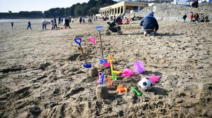 Buckets, spades and toys on the beach during sunny weather at Barry Island in South Wales (Ben Birchall/PA)