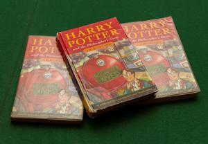 The three copies of Harry Potter and The Philosopher's Stone, all up for auction on May 21. (Hansons/PA)
