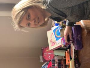 Victoria Hanson with some donated items (Handout/PA)