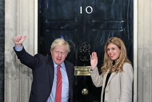 Prime Minister Boris Johnson and fiancee Carrie Symonds arrive in Downing Street (Yui Mok/PA Images)