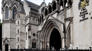 """A convicted drug smuggler was allowed to enter the UK on a """"spousal visa"""", a Family Division court heard"""