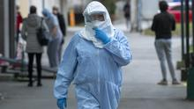 A health worker wears a protective suit at the infectious disease clinic in Zagreb, where the first coronavirus case in Croatia is being treated (Darko Bandic/AP)