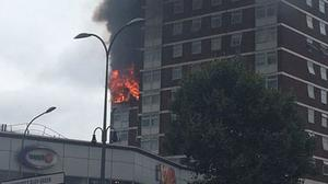 Image taken with permission from the Twitter feed of Liam Twomey of a blaze at Bush Court, Shepherd's Bush Green, London, believed to have been caused by a faulty tumble dryer