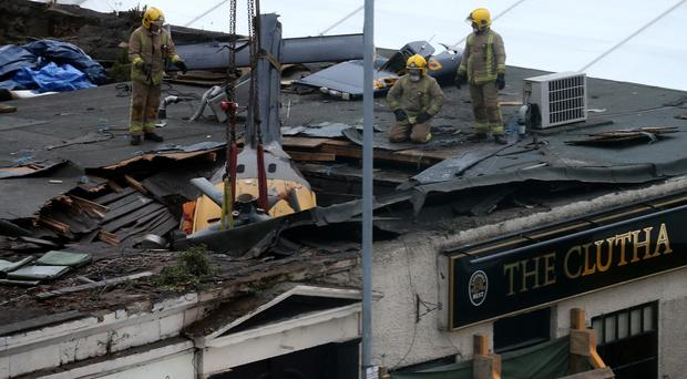 The wreckage of the helicopter which crashed into the roof of the Clutha pub (Andrew Milligan/PA)