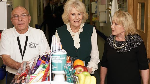 The Duchess of Cornwall, President of Royal Voluntary Service (RVS) and Elaine Paige OBE (right) pushing the trolley with John Thompson (left), at the launch of RVS's Big Trolley Push (Paul Edwards/The Sun/PA)