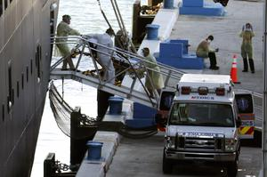 A person on a stretcher is removed from the Zaandam (Lynne Sladky/AP)