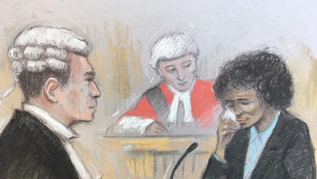 Court artist sketch by Elizabeth Cook of Berlinah Wallace in the dock at Bristol Crown Court being questioned by her barrister Richard Smith QC (left). Wallace is facing charges of murder and applying a corrosive fluid to Mark Van Dongen, who was left paralysed and subsequently took his own life at a euthanasia clinic (Elizabeth Cook/PA)