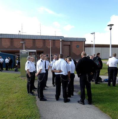 Three prisoners charged with taking a guard hostage at HMP Full Sutton have gone on trial.