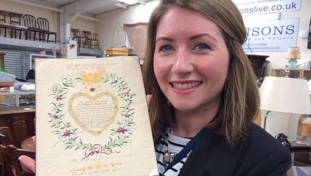 Hansons acutioneers's Isabel Murtough with the 202-year-old Valentine's letter. (Hansons/PA)