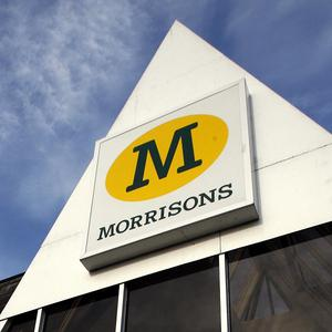 A Morrisons worker has been suspended after wearing a poppy and Help for Heroes wristband
