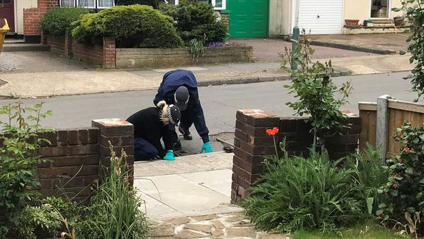 Police officers searching drains in Ashmour Gardens, Romford (Thomas Hornall/PA)