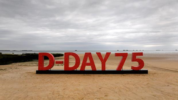 An installation made from 20,000 poppies with messages from supporters of the Royal British Legion goes on display to commemorate the 75th anniversary of the D-Day landings at the beaches of Arromanches in Normandy, France (Doug Peters/PA)