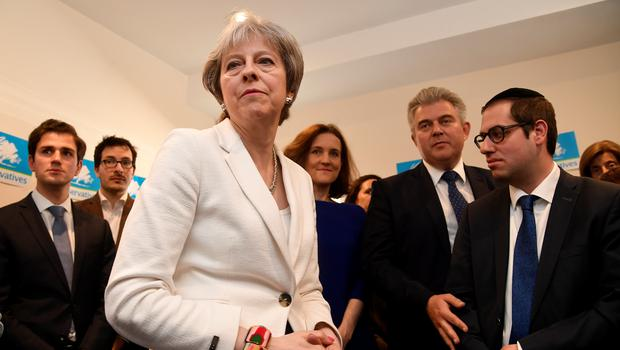 Theresa May speaks to supporters during a visit to Finchley and Golders Green Conservative Association in Barnet, where the Conservative Party retained control (Toby Melville/PA)