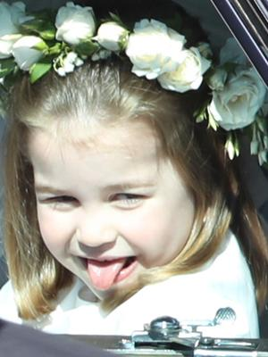 Princess Charlotte sticks out her tongue as she rides in a car to Harry and Meghan's wedding (Andrew Milligan/PA)