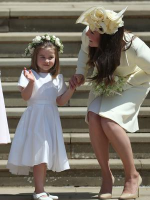 Princess Charlotte and the Duchess of Cambridge on the steps of St George's Chapel after the wedding (Jane Barlow/PA)