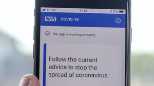 A person on the NHS coronavirus contact tracing app (Steve Parsons/PA)