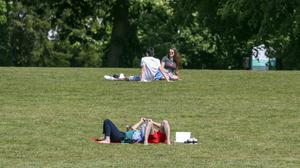 People enjoy the warm weather in Guildford, Surrey (Steve Parsons/PA).