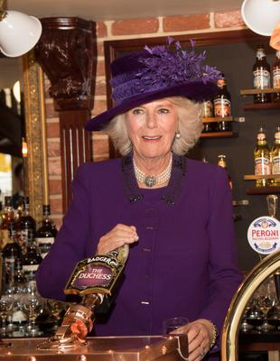 The Duchess of Cornwall pulls a half pint of 'The Duchess' ale inside the Duchess of Cornwall pub