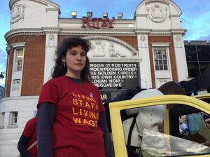 Ritzy employee Holly Fishman Crook joins Picturehouse workers marching past the Ritzy cinema in September. Staff are to take further strike action this month (PA)