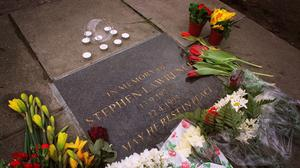 Flowers lie next to a commemorative plaque in Eltham, where teenager Stephen Lawrence was murdered in 1993 (Matthew Fearn/PA)