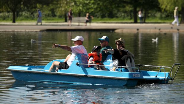 Some people took to a pedalo on Regent's Park lake in an effort to cool down (Yui Mok/PA)
