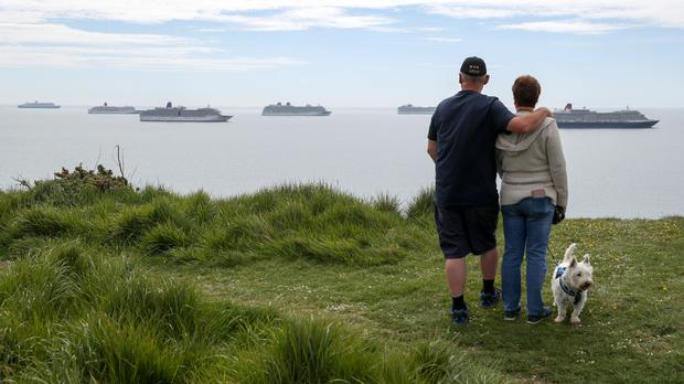 People look out towards cruise ships at berth in Weymouth Bay (Andrew Matthews/PA)